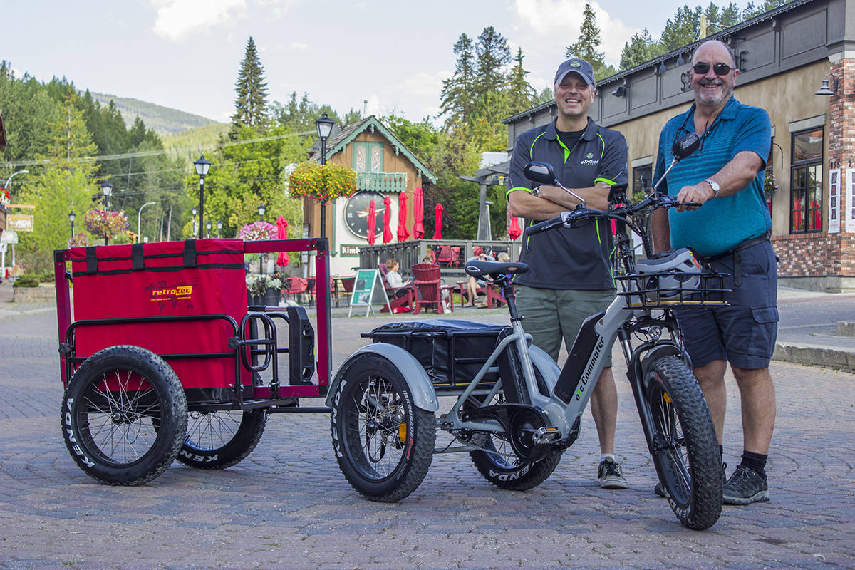 Jim Cunnington (left), owner of eTrikes Canada poses beside the electric trike he sold Ray Smith (right), another Kimberley business owner utilizing the new means of transport to make his own business greener. Paul Rodgers photo.