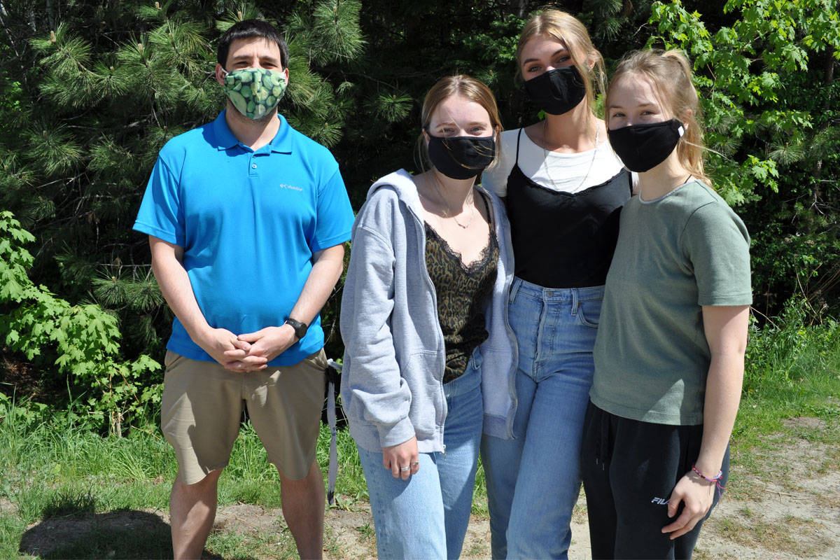 Mount Sentinel Secondary students have successfully pitched a project that will install solar panels at the school. L-R: Teacher Danny Leeming, students Adriana Wilson, Daniela Sirois and Deity Daunheimer. Photo: Tyler Harper